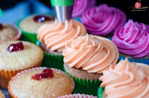 Decorating cupcake by Tiers of Happiness