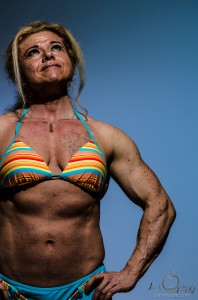Tamara Makar female bodybuilder with blue gelled flash background