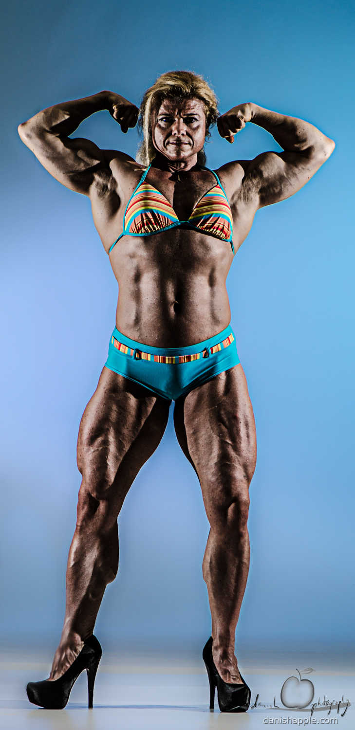 Front double bicep female bodybuilder pose