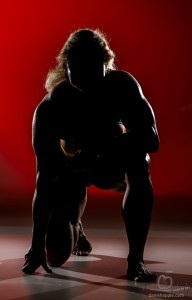 female bodybuilder kneeling shadow