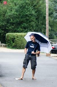 Rain on wedding day - umbrella photo