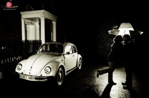 Pre wedding kiss in the rain