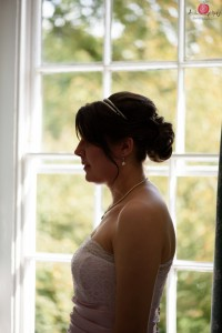 image of bride backlit by window shot with the Nikon D810