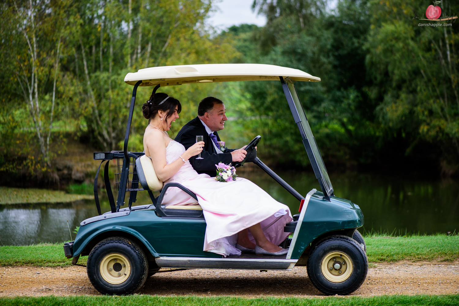 Bride and groom in golf buggy shot with Nikon D810