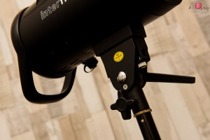 Bottom of Interfit S1 monolight flash unit showing the umbrella mount and air vents